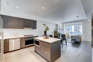Photo 2: 102 1818 14A Street SW in Calgary: Bankview Row/Townhouse for sale : MLS®# A1113047