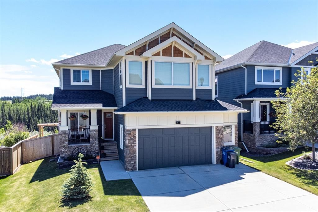 Main Photo: 87 Jumping Pound Terrace: Cochrane Detached for sale : MLS®# A1125041