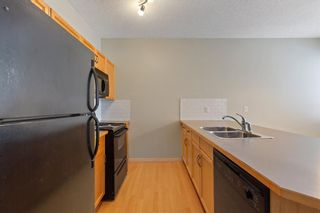 Photo 7: 94 Everridge Gardens SW in Calgary: Evergreen Row/Townhouse for sale : MLS®# A1069502