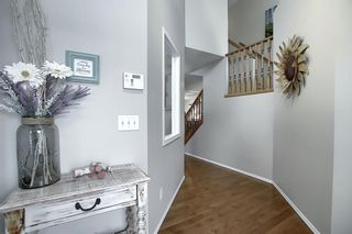 Photo 3: 7720 Springbank Way SW in Calgary: Springbank Hill Detached for sale : MLS®# A1043522