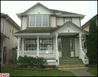 "Photo 1: 18560 64A Avenue in Surrey: Cloverdale BC House for sale in ""Clover Valley Station"" (Cloverdale)  : MLS®# F1004081"