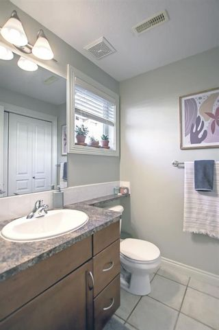 Photo 21: 9 169 Rockyledge View NW in Calgary: Rocky Ridge Row/Townhouse for sale : MLS®# A1153387