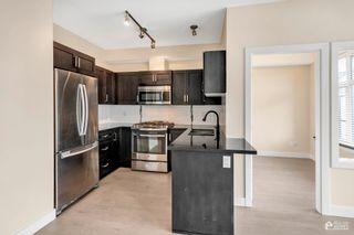 """Photo 9: 204 20078 FRASER Highway in Langley: Langley City Condo for sale in """"Varsity"""" : MLS®# R2602094"""