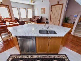 Photo 1: 27 TUSCANY RIDGE Heights NW in Calgary: Tuscany House for sale : MLS®# C4094998
