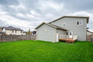 Photo 32: 2 Mackenzie Way: Carstairs Detached for sale : MLS®# A1132226