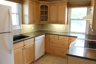 Photo 3: 4312 Amiens Road SW in Calgary: Garrison Woods Semi Detached for sale : MLS®# A1144342