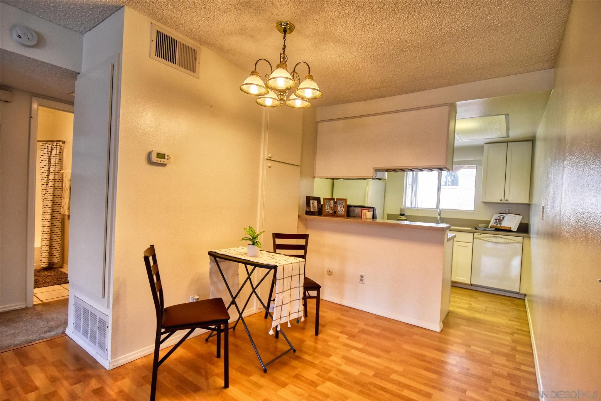 Main Photo: MISSION VALLEY Condo for sale : 2 bedrooms : 6069 Rancho Mission Road #202 in San Diego