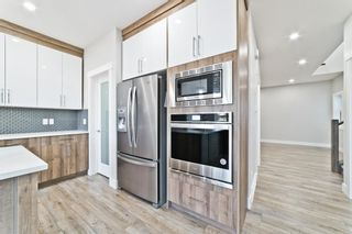 Photo 10: 110 Creekside Way SW in Calgary: C-168 Detached for sale : MLS®# A1144318