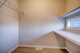 Photo 14: 100 Legacy Main Street SE in Calgary: Legacy Row/Townhouse for sale : MLS®# A1095155