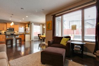 Photo 7: 131 Cougar Plateau Circle SW in Calgary: 2 Storey for sale : MLS®# C3614218