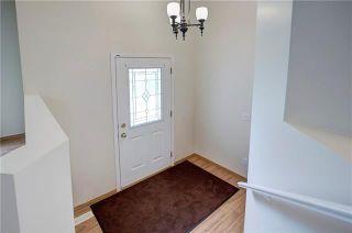 Photo 4: 13 BRIDLEGLEN Manor SW in Calgary: Bridlewood Detached for sale : MLS®# C4302730