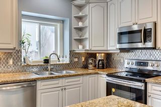 Photo 8: 85 STRATHRIDGE Crescent SW in Calgary: Strathcona Park Detached for sale : MLS®# C4233031