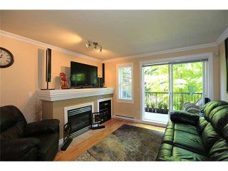 """Photo 2: 25 1561 BOOTH Avenue in Coquitlam: Maillardville Townhouse for sale in """"The Courcelles"""" : MLS®# V1026526"""