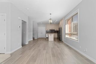Photo 7: 903 Redstone Crescent NE in Calgary: Redstone Row/Townhouse for sale : MLS®# A1096519