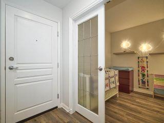 "Photo 5: 102 3099 TERRAVISTA Place in Port Moody: Port Moody Centre Condo for sale in ""THE GLENMORE"" : MLS®# R2500937"