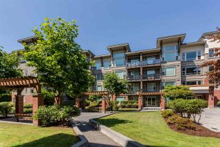 """Photo 1: 409 33538 MARSHALL Road in Abbotsford: Central Abbotsford Condo for sale in """"THE CROSSING"""" : MLS®# R2326134"""