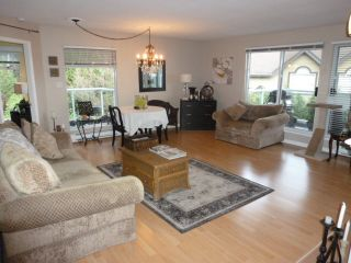 Photo 2: 308 2733 ATLIN PLACE in Coquitlam: Coquitlam East Condo for sale : MLS®# R2039026