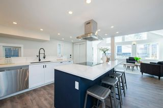 Photo 11: 135 25 Avenue NW in Calgary: Tuxedo Park Detached for sale : MLS®# A1094947