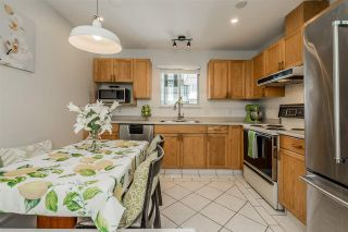 """Photo 7: 309 2733 ATLIN Place in Coquitlam: Coquitlam East Condo for sale in """"Atlin Court"""" : MLS®# R2355096"""