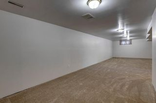 Photo 17: 302 Whitney Crescent SE in Calgary: Willow Park Detached for sale : MLS®# A1146432