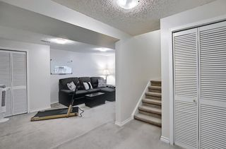 Photo 32: 787 Kingsmere Crescent SW in Calgary: Kingsland Row/Townhouse for sale : MLS®# A1108605