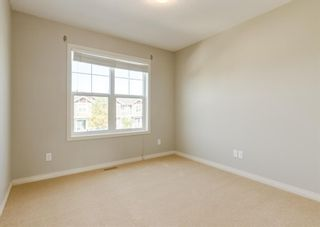 Photo 17: 217 Cranberry Park SE in Calgary: Cranston Row/Townhouse for sale : MLS®# A1127199