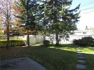 Photo 6: 5707 LAWSON Place SW in Calgary: Lakeview House for sale : MLS®# C4034051