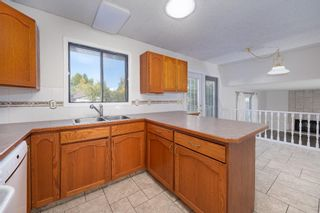 Photo 12: 452 Woodside Road SW in Calgary: Woodlands Detached for sale : MLS®# A1147030