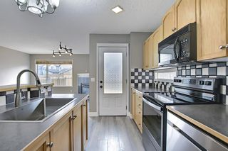 Photo 7: 105 Prestwick Heights SE in Calgary: McKenzie Towne Detached for sale : MLS®# A1126411