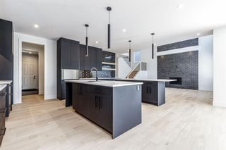Photo 7: 7853 8A Avenue SW in Calgary: West Springs Detached for sale : MLS®# A1136445