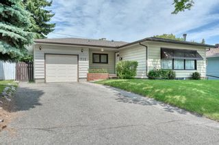Photo 1: 712 75 Avenue SW in Calgary: Kingsland Detached for sale : MLS®# A1016044
