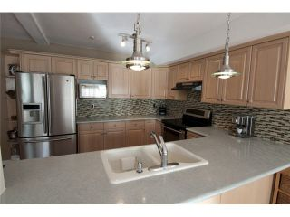 """Photo 2: 20 39754 GOVERNMENT Road in Squamish: Northyards Townhouse for sale in """"MAPLE TREE COURT"""" : MLS®# V1076411"""