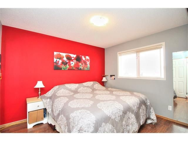 Photo 14: Photos: 89 BRIDLEWOOD Park SW in Calgary: Bridlewood House for sale : MLS®# C4033119