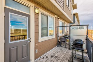 Photo 10: 504 Panatella Walk NW in Calgary: Panorama Hills Row/Townhouse for sale : MLS®# A1153133