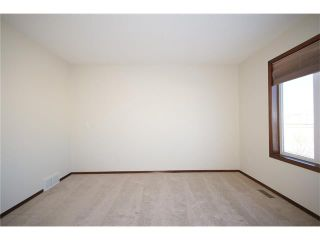 Photo 27: 103 WEST POINTE Court: Cochrane House for sale : MLS®# C4042878