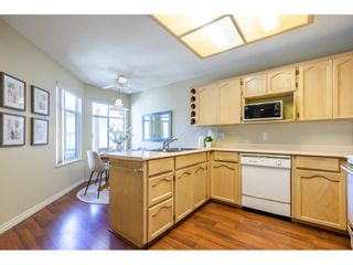 """Photo 14: 106 19649 53 Avenue in Langley: Langley City Townhouse for sale in """"Huntsfield Green"""" : MLS®# R2595915"""