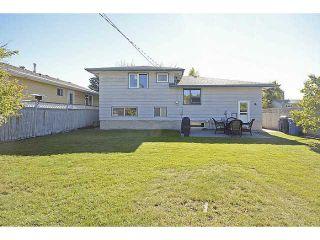 Photo 2: 1404 LAKE MICHIGAN Crescent SE in CALGARY: Lk Bonavista Downs Residential Detached Single Family for sale (Calgary)  : MLS®# C3635964