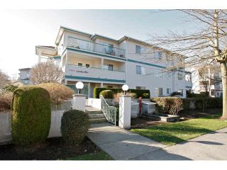 "Photo 1: 311 5955 177B Street in Surrey: Cloverdale BC Condo for sale in ""WINDSOR PLACE"" (Cloverdale)  : MLS®# F1433073"