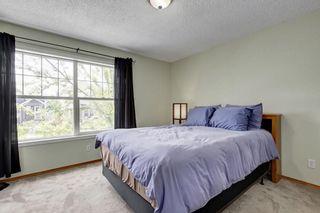 Photo 11: 26 HIDDEN RANCH Road NW in Calgary: Hidden Valley House for sale