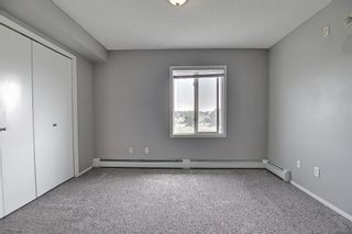 Photo 30: 6413 304 Mackenzie Way SW: Airdrie Apartment for sale : MLS®# A1128019
