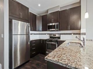 Photo 5: 2004 881 Sage Valley Boulevard NW in Calgary: Sage Hill Row/Townhouse for sale : MLS®# A1085276