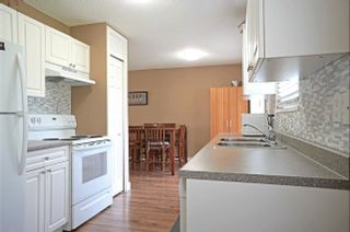 Photo 2: 13321 STAMFORD Place in Surrey: Queen Mary Park Surrey House for sale : MLS®# R2603821