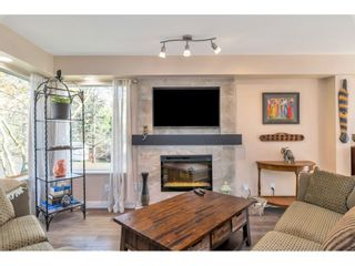 """Photo 3: 232 13900 HYLAND Road in Surrey: East Newton Townhouse for sale in """"Hyland Grove"""" : MLS®# R2519167"""