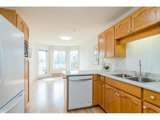 """Photo 8: 204 5375 205 Street in Langley: Langley City Condo for sale in """"Glenmont Park"""" : MLS®# R2500306"""