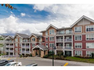 "Photo 1: 215 6440 194 Street in Surrey: Clayton Condo for sale in ""WATER STONE"" (Cloverdale)  : MLS®# R2319646"