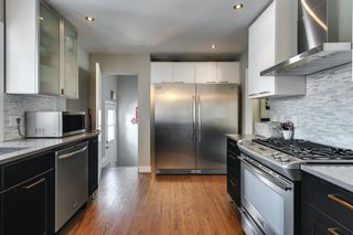 Photo 13: 8207 7 Street SW in Calgary: Kingsland Detached for sale : MLS®# A1080645