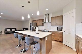 Photo 9: 812 177 Street SW in Edmonton: Zone 56 House for sale : MLS®# E4229396