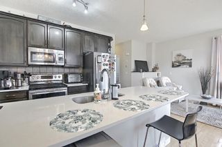 Photo 11: 6 Everridge Gardens SW in Calgary: Evergreen Row/Townhouse for sale : MLS®# A1145824