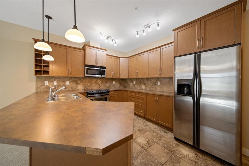FEATURED LISTING: 211 - 35 Aspenmont Heights Southwest Calgary