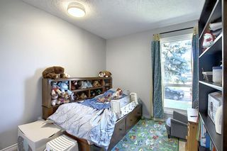 Photo 21: 408 QUEENSLAND Circle SE in Calgary: Queensland Detached for sale : MLS®# A1020270